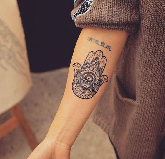 evil eye hamsa tattoo