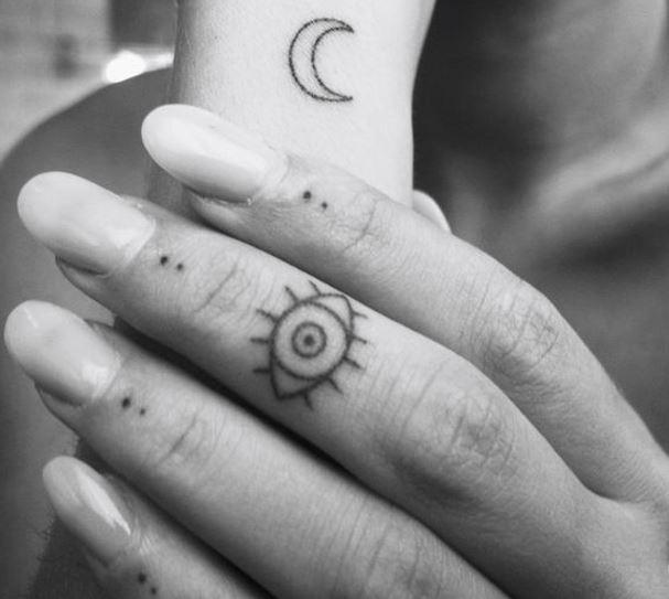 evil eye tattoo finger